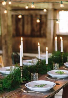 Festoon lights, candles and greenery
