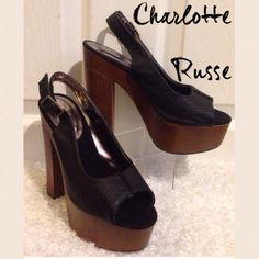 """NEW Charlotte Russe Platform Block Heels Size 7 CHARLOTTE RUSSE  Black and Brown Platform Open Toe Block Heel Shoes  Size 7  Heel height 5.5"""" These are NEW and have not been worn, see pictures. No box or tags  There are faint scuff marks on the back of each heel, see closeup. Otherwise GREAT condition.  Listing is for the shoes only. Charlotte Russe Shoes Platforms"""