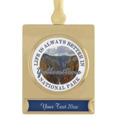 Funny Life Is Always Better In Yellowstone Gold Plated Ornament Life is always better in Yellowstone National Park, Wyoming . This funny souvenir logo style design features landscape nature travel photography of a the famous upper and lower Yellowstone Falls with storm clouds looming in the background. Great gift for a hiker, climber or park lover.