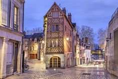 Half-timbered house in the center of Orleans - Street, paved with stone blocks and half-timbered house in the center of Orleans, France