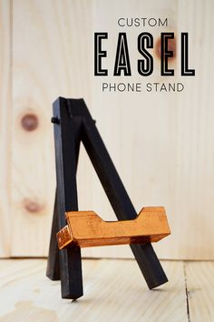 Create your own custom easel phone stand using popsicle sticks.