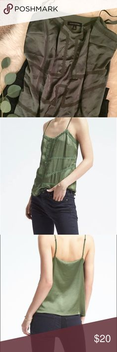 Banana Republic Lace-Trim Cami Tank - Green This luxurious cami is a silky 100% polyester and drapes over a soft, lightweight liner underneath. The BR website called it kale green - but to me it is a softer sage or eucalyptus green. Adjustable straps! Has great bias cuts for figure forming cut through the chest. Perfect for layering or by itself. Banana Republic Tops Camisoles