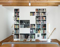 Keeping everything in its place is critical in this tiny home. Shelving designed by Kirkpatrick helps immensely. He's also designed the coffee table; the couch was picked up at a second-hand store. The vaporproof ceiling light is from RAB lighting. Bookshelves In Living Room, Living Room Storage, Living Room Interior, Modern Bookshelf, Bookshelf Design, Bookcases, Small Space Design, Small Space Living, Small Spaces