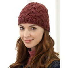 Cable Hat in Bernat Satin. Discover more Patterns by Bernat at LoveKnitting. We stock patterns, yarn, needles and books from all of your favorite brands.