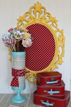Love that yellow frame with red/white polka dot fabric!!  Would make a great board to pin some pictures!