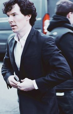I love the way he unbuttons his suit coat. Basically I love everything he does :)