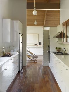 Walnut flooring, white kitchen beautiful :) Contemporary / Midcentury In An Edward Fickett Home