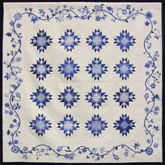 "2016 Raffle Quilt: ""Scraps Gone Blue"" by the Quilters Anonymous Guild's Scraps satellite group. Quilted by Cindy Glancy"