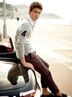 Sweater layered with button up shirt and pants
