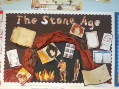 Stone Age display. The cave and fire are made from crepe paper and the Stone Age people were printed and laminated.