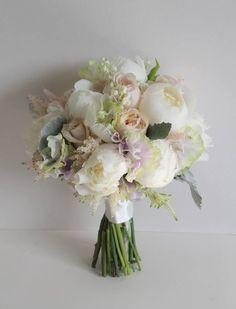 White Peonies, fresh Lily of the Valley, White Lilac, Sweet Peas, palest pink Astilbe, Senecio, David Austin's Keira Roses