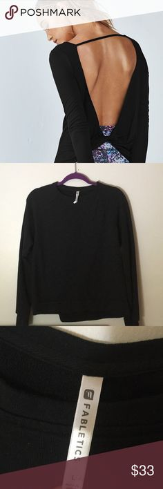 Fabletics Fabletics black open backs sweater in good condition perfect for cold winter really warm and cozy! Used the model for the back design almost like it it doesn't have the string on it Fabletics Tops Sweatshirts & Hoodies
