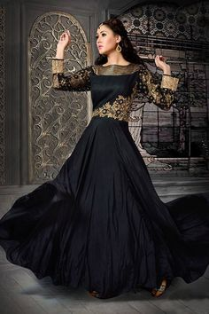 A sensuous #anarkali in the rich combination of black and gold. Buy Anarkali suits online - http://www.aishwaryadesignstudio.com/designer-black-anarkali-suit-2