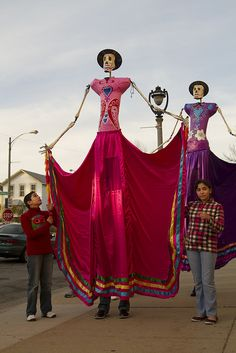 Tall ladies. Dia de los muertos. The Heard Museum used to have these at their fabulous DOTD festival years ago. Took many students for a great day. Miss it.