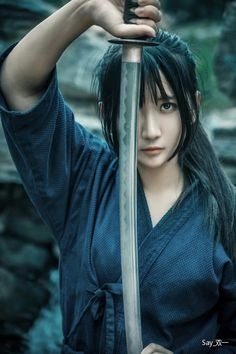 KATANA. (JAPANESE SWORD) Normally women do not fight using KATANA, this pic would be a cut from a movie. But so cool.