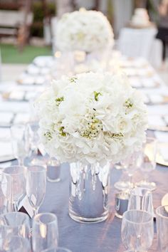We're a little bit gaga over Whitney + Jeff's modern yet romantic Florida wedding. If their poolside ceremony didn't rock your socks off, their sleek reception will. The frosty grey color scheme and sparkling crystals were a welcome change to the palm tree-lined venue at The National Hotel. Lush white flowers sat atop silk runners …