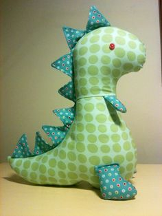 this is soo cute:)  Dinosaur plushie--could turn this into a dragon by adding some quilted wings.