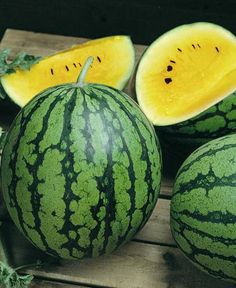 Yellow Watermelon!!  A yellow watermelon is a fruit that is nearly identical to a traditional watermelon, but the flesh inside is a bright yellow color instead of red or pink. The taste is also very similar, though some say it has a sweeter or more honey-like taste