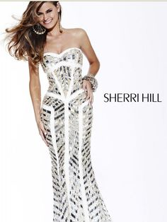 Dazzle everyone in this sparkling number by Sherri Hill. This wonderful dress features a sweetheart neckline and fitted bodice with asymmetrical lines throughout. The trumpet silhouette adds shape to virtually any body type. Shine from every angle in this wonderful gown. Perfect for prom or any super formal affair!