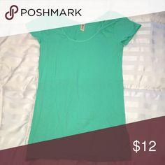 Plain mint green nylon and spandex tshirt Worn once. Tight fit. Mint green color Nikibiki Tops Tees - Short Sleeve