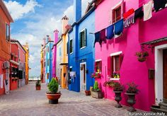 The local homes in Burano are indeed this cheerfully bright! The tradition of painting homes bright colors has been going on for decades. #italy #italian #venice #colors #colours #bright #getaway #seetheworld #seeeverything #explore #destination #travel #travelbug #vacation #vacationtime #timelesstravels