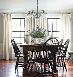 black windsor chairs with dark wood table.  Gorgeous windows too!