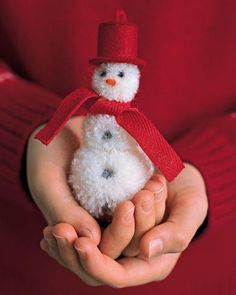 How to make a Pom-Pom Snowman! This is a great idea for a Christmas tree ornament. You'll need pom-poms, yarn, thread, felt and ribbon.