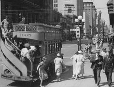 In this photo, we're at the corner of Olive Street and West 7th Street, downtown Los Angeles in 1937. We often see those semaphore traffic lights in old movies, but I don't recall seeing double decker buses with the open-air top floor. Compared with their London equivalent, they seem quite dainty, don't they?