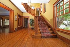 Traditional Staircase with Carpet, High ceiling, Hardwood floors