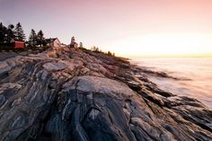Dawn brushes the rocks below Pemaquid Point Light, featured on the Maine state quarter.