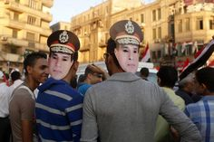 SHOW OF SUPPORT: Protesters wore masks depicting Gen. Abdel Fattah Al Sisi in Tahrir Square in Cairo Friday. Gen. Sisi, Egypt's powerful top general, asked Egyptians to protest to support the military's right to confront supporters of ousted President Mohammed Morsi (Asmaa Waguih/Reuters)