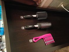 Small things to decrease clutter....used  Command™ Brand Hooks to hang brushes and combs on the side of towel cabinet.