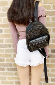 Signature coated canvas Inside zip and multifunction pockets Zip closure, fabric lining Top handle with drop Outside zip pocket Adjustable shoulder strapsx (L) x (H) x (W) Leather Backpack, Mini Backpack, Backpack Bags, Fashion Backpack, Consumer Behaviour, Backpacks, Metallic, Handle, Closure
