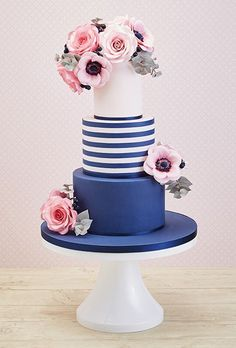 Blue and white stripe wedding cake with pink flowers. beautiful wedding cake.