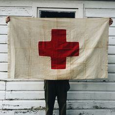 - WWII Red Cross Medical Station Flag - Made Of A Cotton Gauze Material - Two Piece Hand Cut Red Cross Symbol Patch - Single Stitch Machine Sewn Around Patch And Borders - Some Wear And Damage From Us