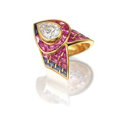 A fine diamond and sapphire 'Claw' dress ring