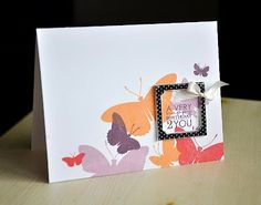 Love the simple die cut frame tied with a bow.  By Maile Belles
