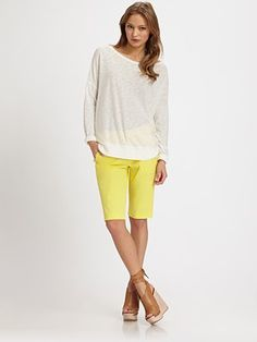 The yellow pants above are an example of Bermuda shorts because they are tailored and fall about 1 inch above the knee.