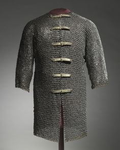 Hauberk, c. 1400- 1450 Germany (?), first half 15th Century  steel and brass rings, riveted with modern buckles and straps, Overall - l:76.20 cm (l:30 inches) Wt: 10.47 kg Sleeves - l:43.20 cm (l:17 inches). Gift of John L. Severance 1923.1120