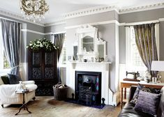 The grey walls allow the white accents to really pop in this beautiful living room House Styles, Grey Painted Walls, 1900s House, House Inspiration, House Interior, Home, Living Room Grey, House, Home Living Room