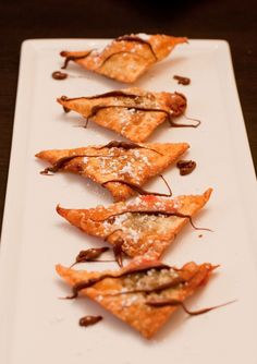 """Fried Wonton Dessert from EatPlayCreate.com: """"Fried wonton stuffed with strawberry, bananas and Nutella. Dessert to die for."""""""