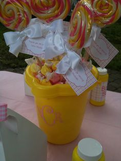 Super cute pink and yellow birthday party centerpieces http://katelandersevents.blogspot.com/2011/01/pink-yellow-first-birthday-party-client.html