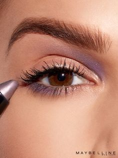 Looking for a subtle eye look with a pop of color? Try this soft purple look from Maybelline with  Color Tattoo Crayon in 'Lilac Lust'. This easy-to-use eye shadow glides on to deliver intense color that lasts up to 24 hours.