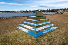 Artist Shirin Abedinirad (previously) just completed work on her latest sculpture, Mirrored Ziggurat, a pyramid of mirrors resting near a bay in Sydney, Australia as part of the Underbelly Arts Festival.