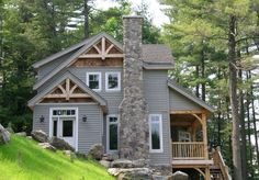 While house should be cedar shake but nice mix with wood beams and white trim