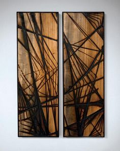 Glass burned wood art by Jonah Ward: appreciate the verticallity, but think they are burnt too much. Definitely dig it though.
