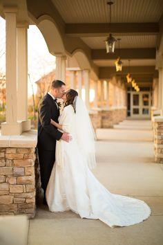 Romantic image of bride and groom at the walkway of The Golf Club at Lansdowne.