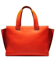 Hot Tropic: Bazaar's pick for the best accessories for fall, starting with best pops of color to embrace —Giorgio Armani suede and leather tote