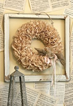 VARIATION OF COFFEE FILTER WREATH.  LIKE THE SMALL TOUCHES OF BURLAP AND ROSETTES