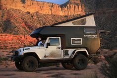 Jeep Action Camper offers a pop-up roof, a fiberglass body, a king-size bed, plenty of storage, a mini-kitchen with three-burner stove and refrigerator, a toilet with optional kitchen sink shower, and a fold-up dining area.